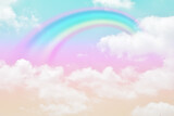 Fototapeta Tęcza - Fantasy magical landscape the rainbow on sky abstract with a pastel colored background and wallpaper.