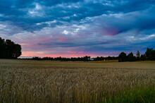 Dramatic Sunset Over Fields Ne...