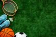 Leinwandbild Motiv Flat lay of sport balls - football, basketball on grass. Top view copy space