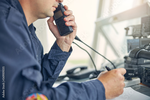 Adult male listen to the order from commander on the radio Canvas