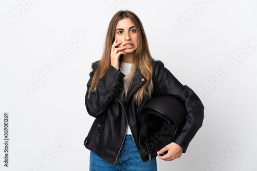 Obraz Young Woman holding a motorcycle helmet over isolated white background nervous and scared - fototapety do salonu