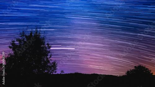 Fototapeta Beautiful star trail image during the night. obraz