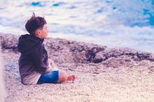 Little Boy Child Meditating On The Beach