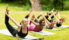 Happy Diverse Girls Doing Bow Yoga Pose On Outdoor Yoga Practice In Nature