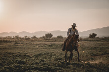 Full Length Of Man Horseback Riding Against Sky