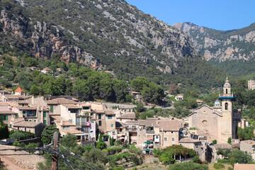 Fototapeta na wymiar View of the city of Valdemossa and the mountains against the blue sky, Majorca. Spain.