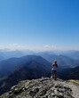 Women Standing On Mountain Against Sky