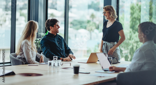 Obraz Group of happy corporate people in a meeting - fototapety do salonu