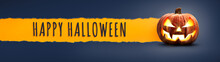The Words Happy Halloween On A Textured Paper Tear With A Halloween Lantern, Jack O Lantern On Dark Blue Banner Background