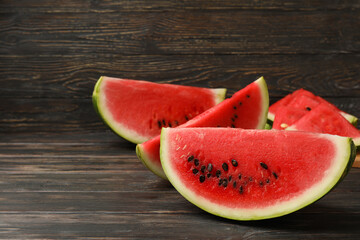Composition with watermelon slices on wooden background. Summer fruit