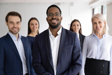 Diverse Professionals Bank Employees Company Staff Members In Formal Wear, 5 Businesspeople Lead By African Ethnicity Leader Posing Standing Together In Office. Young Aged Specialists Portrait Concept