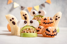 Healthy Fruit Halloween Treats. Banana Ghosts, Clementine Orange Pumpkins And Apple Monster Mounts