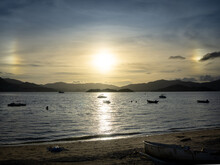 Sun Dogs On The Beach In Ma On Shan. Ma On Shan Is A New Town Along The Eastern Coast Of Tolo Harbour In The New Territories Of Hong Kong
