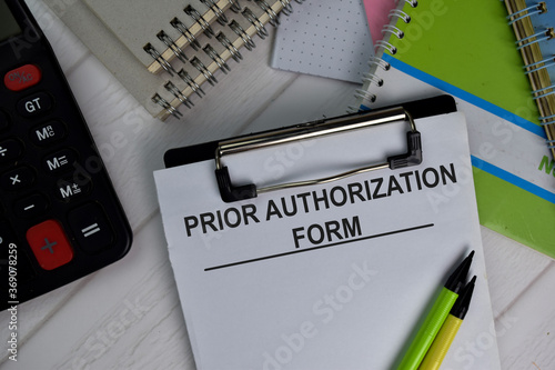 Photo Prior Authorization Form write on paperwork isolated on office desk