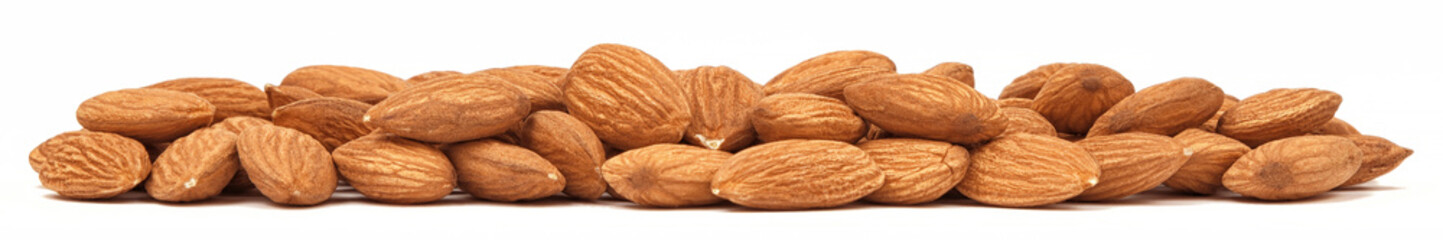 Heap of Almonds isolated on white background. Panorama macro of Almond nuts. Organic food