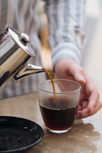Person Pouring Hot Black Coffee