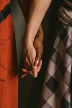 Close Up Of Young Couple Holding Hands