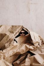 Creative Person Hiding In Pile...