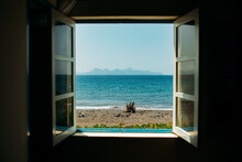 View From Window At Scenic Seaside On Summer Day