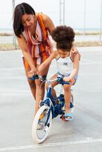 Mom Teaching Daughter To Ride A Bike