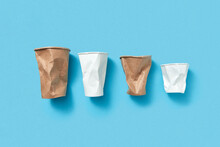 Crumpled Paper Cups On Blue.