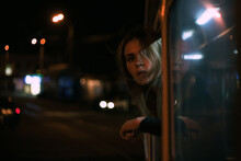 Portrait Of A Girl From The Window Of A Tram At Night.