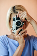 Blonde Woman Taking A Picture