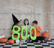 Halloween Children Holding Cra...