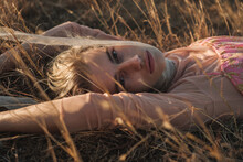 Portrait Of Sensual Blond Woman Lying In The Grass