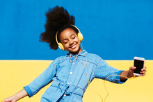 Delighted Black Girl Dancing With Closed Eyes