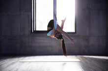 Sexy Young Woman Practice Yoga Indoor