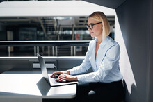 Young Businesswoman Working In A Pod