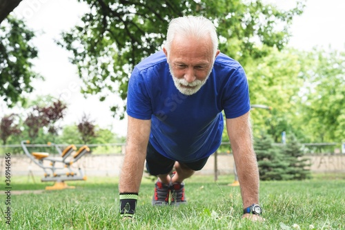 Man exercising on grass at park Canvas