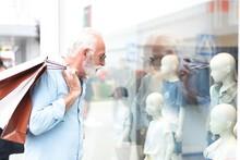 Senior Man Window Shopping In City