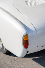 The Taillight Of A Classic White Car