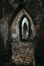 Ghost Standing In Arch Of Old Building