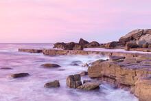 Soft Pastel Sunrise Over Rocky...