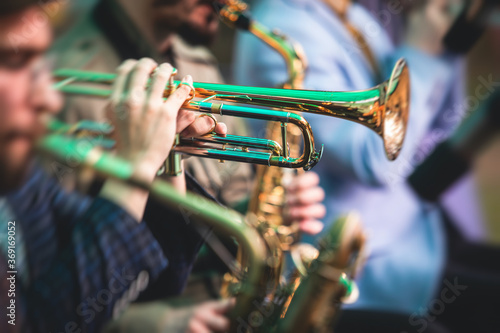 Papel de parede Concert view of a male trumpeter, professional trumpet player with vocalist and
