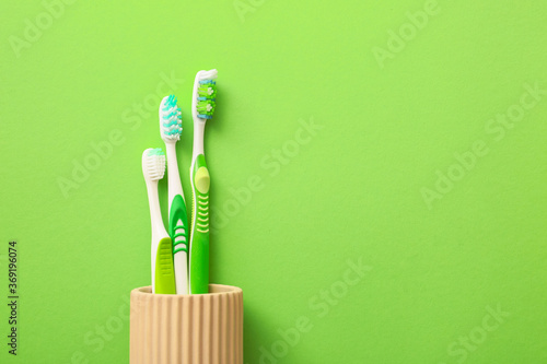 Obraz Tooth brushes on color background - fototapety do salonu