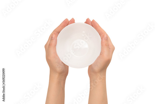 Photo White bowl in woman hand isolated on white.