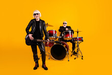 Portrait Of His He Her She Nice Attractive Trendy Elderly Cheerful Grey-haired Couple Musicians Art Performing Single Stage Scene Fame Isolated Over Bright Vivid Shine Vibrant Yellow Color Background