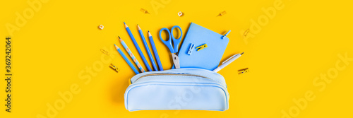 Cuadros en Lienzo Web banner with School writing materials: pencils, scissors, notepad, pen case on yellow background