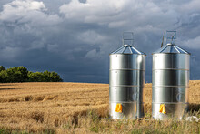 Photo Of Two Silver Silos On F...