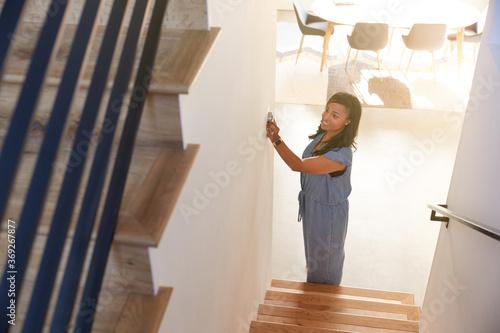 Obraz Woman Adjusting Digital Central Heating Thermostat At Home - fototapety do salonu
