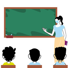 Teacher Wearing Masks In The Classroom With Her Students