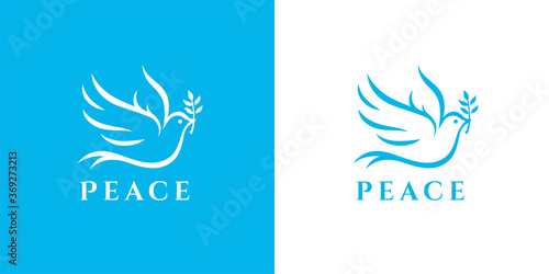 Photo Flying peace dove with olive branch logo symbol