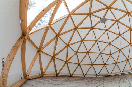 Stampa su Tela Interior of large geodesic wooden dome tent with window and view to forest