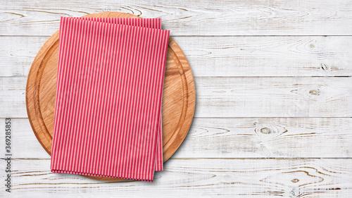 Fototapeta Empty pizza board and red napkin on planks. obraz