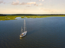 Aerial View Of Sailboat Moored Off The Coast Of South Carolina At Sunset.