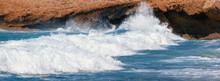Sea Wave Crashing On A Rocky Shore